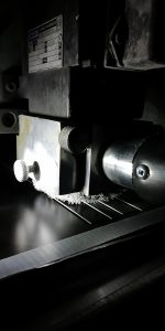 High vacuum system being used to extract composite dust through an on-tool extraction system.